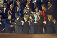 Photograph: First Lady Hillary Rodham Clinton and guests applaud Captain John Cherrey.