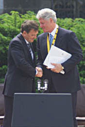 President Clinton shakes hands with German Chancellor Gerhard Schroeder after being presented with the Charlemagne Prize.