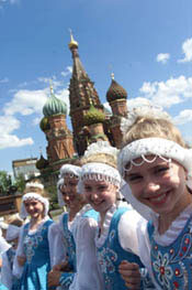 A group of young girls in dance costumes performed outside the Kremlin in Red Square.