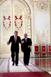 Presidents Clinton and Putin discuss issues as they walk through the Kremlin on their way to the Joint Press Conference.