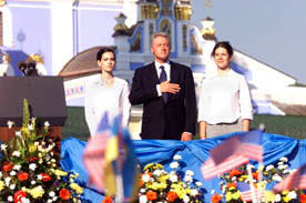 The President, accompanied by Ukrainian students Kateryna Yasko, left, and Natalia Voinorovska, listens to our national anthem as part of the festivities at St. Michael's Square.