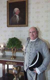 To honor President John Adams's arrival at the White House 200 years ago, President Adams is portrayed for today's reenactment ceremony by Steven Perlman of Philadelphia.  He is posing here in front of President Adams's portrait in the Blue Room.