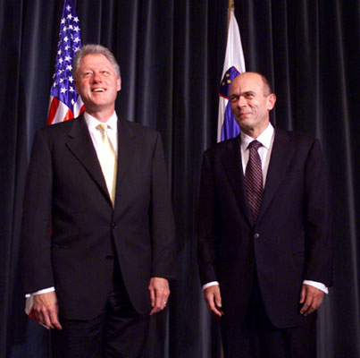 President Clinton stands with Prime Minister Janez Drnovsek of Slovenia in the Grand Hall of the Presidential Palace.