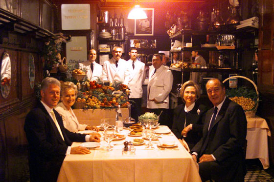 The President and the First Lady enjoy a private dinner with President and Mrs. Jacques Chirac at L'Amis Louis in Paris.
