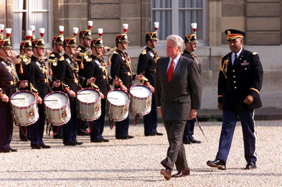 The President reviews the troops at Elysee Palace.