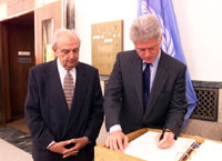 President Clinton signs the guest book after meeting with International Labor Organization leaders.