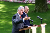 President Clinton answers a question during a press conference in the garden of Elysee Palace.