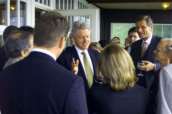 President Clinton converses with guests at a dinner hosted by Chancellor and Mrs. Schroeder at the Rolandsbögen Restaurant in Bonn.