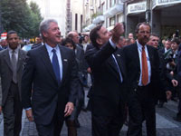 President Clinton and Chancellor Schroeder admire the cheering crowds on the streets of Cologne.