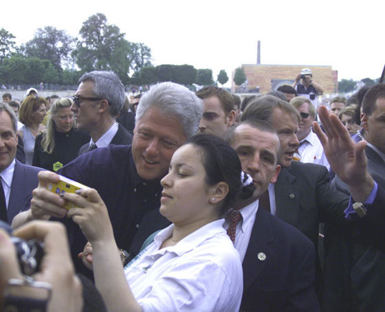 The President stops near the Jardin de Tuileries to greet Parisians and pose for photographs.