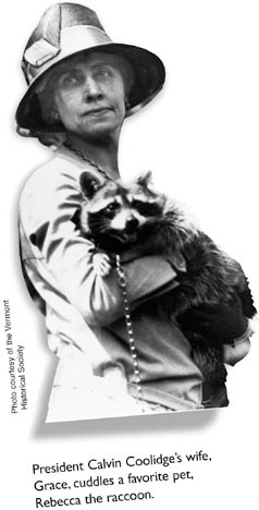 President Calvin Coolidge's wife, Grace, cuddles a favorite pet, Rebecca the racoon.