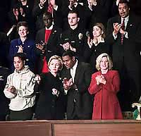 Photograph: First Lady Hillary Rodham Clinton and guests applaud during the President's address.