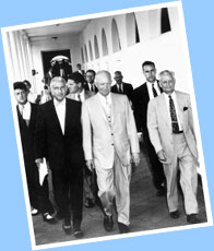 President Eisenhower (center) walks with his Chief of Staff, Sherman Adams - far right.