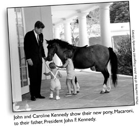 John and Caroline Kennedy show their new pony, Macaroni, to their father, President John F. Kennedy.