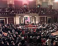 Photograph: Members of Congress rise to applaud during the President's address.
