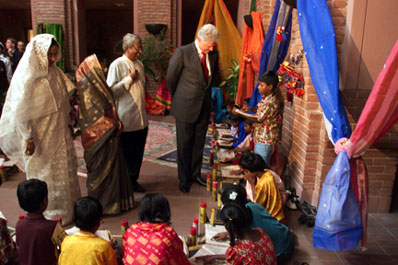 President Clinton observes students during a school event for the people of Joypura, US Embassy, Bangladesh.
