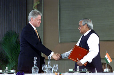 President Clinton and Prime Minister Atal Bihari Vajpayee shake hands after signing a vision statement, Hyderabad House, New Delhi.