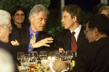 President Clinton talks with British Prime Minister Tony Blair during a dinner at the Villa La Pietra in Florence.