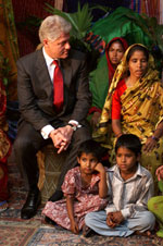 President Clinton listens to a woman from the Joypura village during the micro-credit event held at the us embassy, Bangladesh.