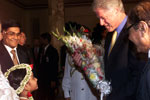 President Clinton is presented with flowers upon his arrival at the official dinner at Bangabhawan, Bangladesh.
