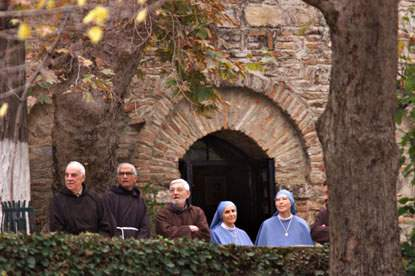 Monks and nuns at Virgin Mary's Grotto in Ephesus, Turkey await a visit by the First Family.