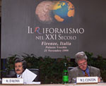 Italian Prime Minister Massimo D'Alema seated beside President Clinton at the