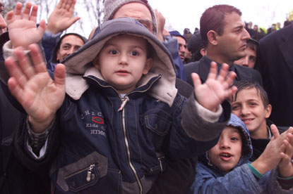 A young earthquake survivor in Izmit waves to the camera.