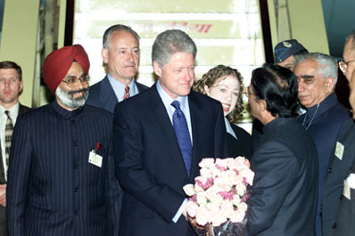 President Clinton and daughter Chelsea are greeted by Indian officials upon their arrival at Palam Air Force Station, New Delhi.