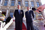 President Clinton stands on the steps of Ciragan Palace with Ireland Prime Minister Bertie Ahern before their meeting.