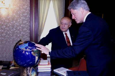 President Demirel and President Clinton employ a globe in their discussions at the Presidential Palace.