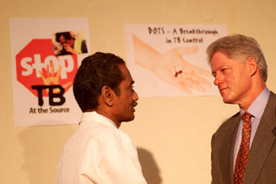 President Clinton greets Dr. Akbar Yazdani, Medical Officer, at Mahavir Trust Hospital.  Hyderabad, India.