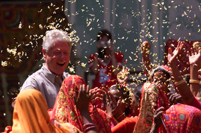 Naila village women shower the President with flower petals as part of a traditional ceremony.