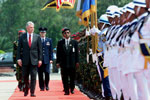President Clinton reviews the Honor Guard during the arrival ceremony at Zia International Airport, Bangladesh.