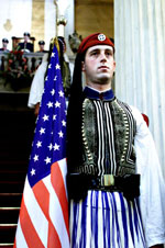 A Greek guard stands outside the Presidential Palace during the departure ceremony for the Clintons.
