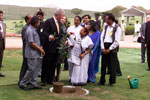 President Clinton and daughter Chelsea participate in a Gandhi tree planting ceremony, Rajghat Samadhi.  New Delhi.