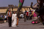 President Clinton and Minister of State, Tourism, Art and Culture Bina Kak pass a cordon of elephants at the Amber Fort.