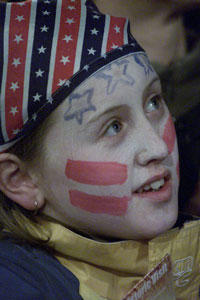 A child listens to the historic speech made by President Clinton in