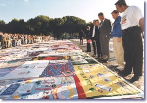 The President and First Lady at the Names Memorial AIDS Quilt exposition in Washington, DC
