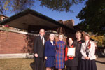 Staff from the Frederick C. Robie House and The Frank Lloyd Wright Home and Studio Foundation join with the First Lady to display the Robie House's official Save America's Treasures project designation.