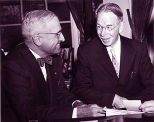 Ira Smith (right) confers with President Harry Truman (left) about his mail.