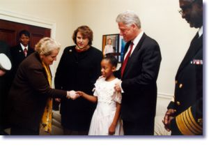 The President, Secretary Albright, and Surgeon General Satcher greet Cynthia and Amy Slemmer at the World AIDS Day Commemoration (12/1/98)