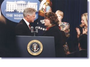 The President and Amy Slemmer at the World AIDS Day Commemoration (12/1/98)